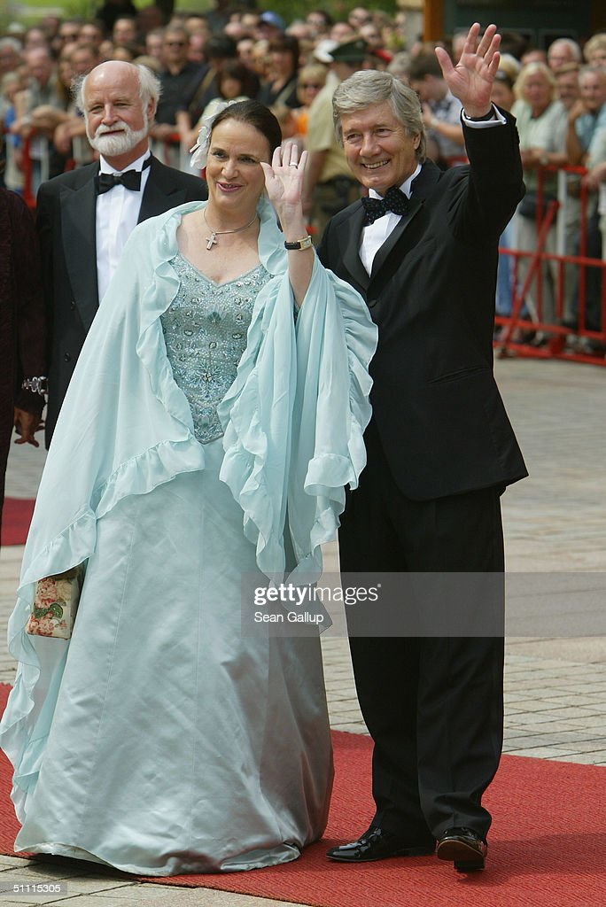 German actor Christian Wolff and his wife arrive for the opening performance of Richard Wagner's 'Parsifal' July 25, 2004 on the first day of the 93rd Richard Wagner Festival in Bayreuth, Germany.
