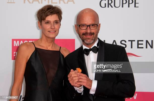 German actor Christoph Maria Herbst and his wife Gisi pose on the red carpet prior to the annual German film and television awards 'Golden Camera' of...