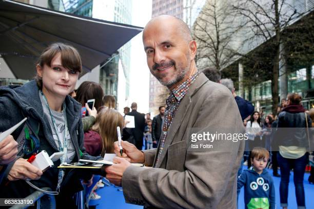 German actor Christoph Maria Herbst with fans during the 'Die Schluempfe Das verlorene Dorf' premiere at Sony Centre on April 2 2017 in Berlin Germany