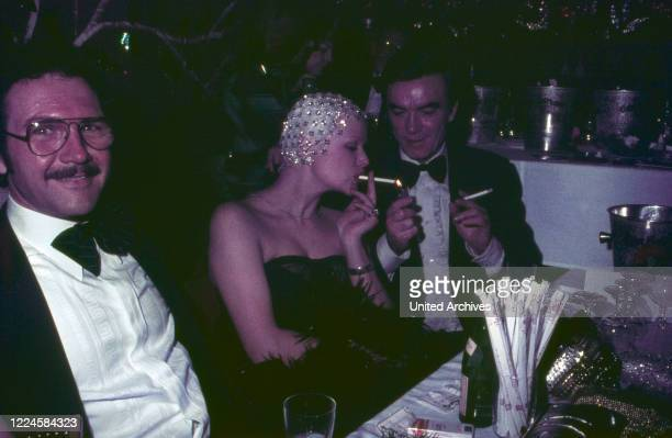 German actor Claus Biederstaedt at an evening event Germany 1970s