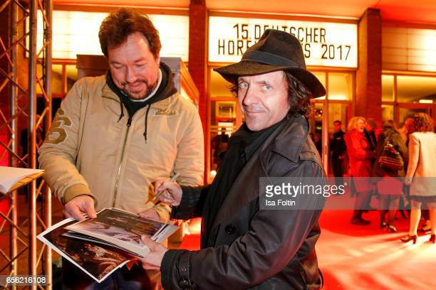 German actor David Bennent with a fan at the Deutscher Hoerfilmpreis at Kino International on March 21 2017 in Berlin Germany