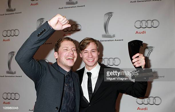 German actor David Kross and Marco Kreuzpaintner pose with a trophy during the Audi Generation Award 2010 at Hotel Bayerischer Hof on October 23 2010...