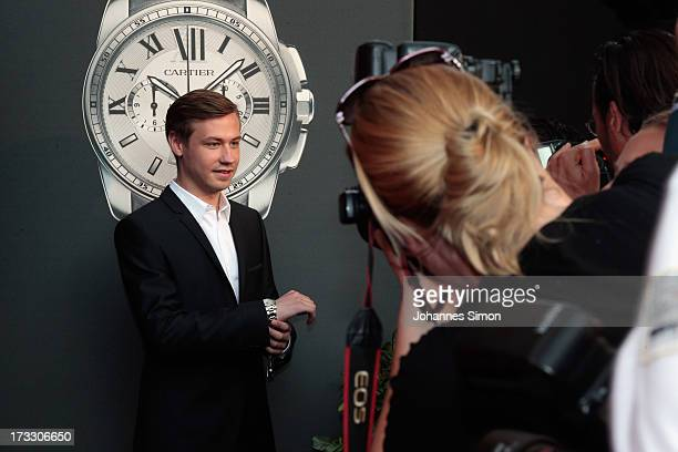 German actor David Kross arrives for the 'League of Gentlemen' launch of the Calibre de Cartier chronograph at Heart Club on July 11 2013 in Munich...