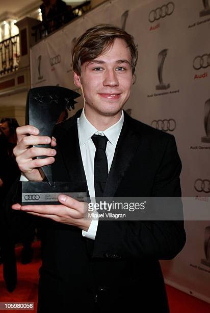 German actor David Kross poses with a trophy during the Audi Generation Award 2010 at Hotel Bayerischer Hof on October 23 2010 in Munich Germany