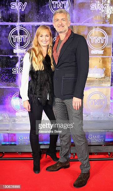 German actor Dominic Raacke and his girlfriend Janine Barth attends 'Games of Thrones' Preview Event of TNT Serie and Sky at Hotel Bayerischer Hof on...