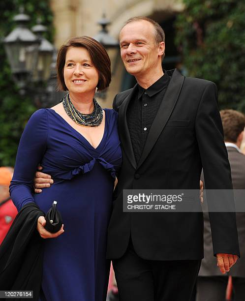 German actor Edgar Selge and his wife actress Franziska Walser pose on the red carpet at the Festspielhaus ahead of the opening performance of...