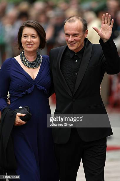 German actor Edgar Selge and his wife Franziska Walser arrive for the Bayreuth festival 2011 premiere on July 25 2011 in Bayreuth Germany