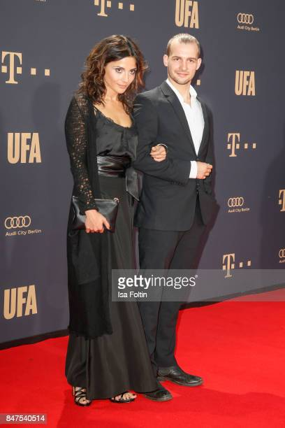 German actor Eric Stehfest and Gamze Senol attend the UFA 100th anniversary celebration at Palais am Funkturm on September 15 2017 in Berlin Germany