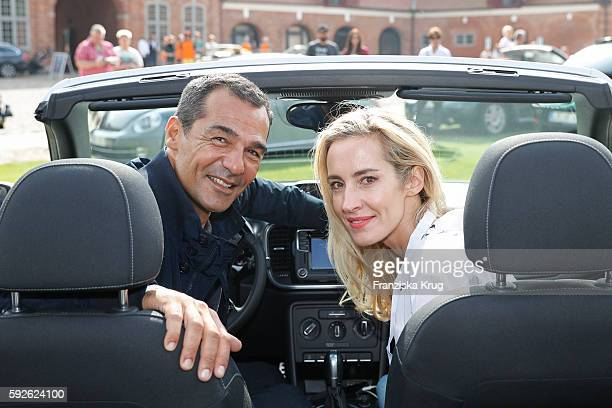 German actor Erol Sander and his wife Caroline Goddet attend the 12th Beetle Sunshine Tour To Travemuende the 12th Beetle Sunshine Tour on August 20...