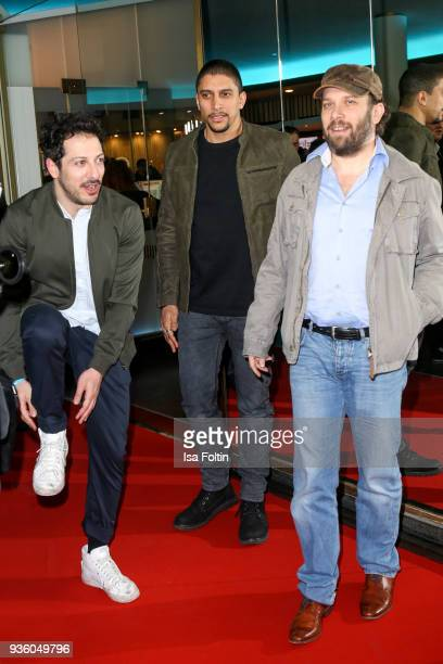 German actor Fahri Yardim German singer Andreas Bourani and German presenter and actor Christian Ulmen during the 'Jerks' premiere at Zoo Palast on...