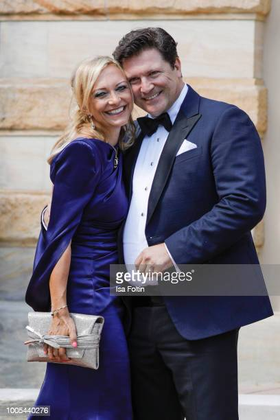 German actor Francis Fulton Smith and his girlfriend Claudia Hillmeier during the opening ceremony of the Bayreuth Festival at Bayreuth Festspielhaus...