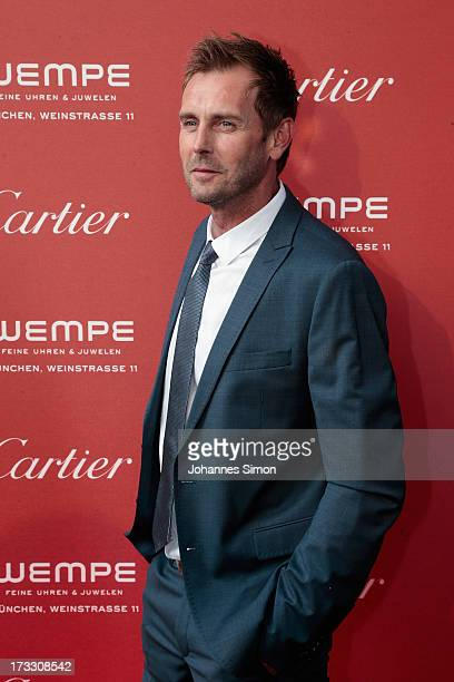 German actor Gerrit Grassl arrives for the 'League of Gentlemen' launch of the Calibre de Cartier chronograph at Heart Club on July 11 2013 in Munich...