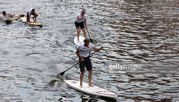 German actor Goetz Otto competes during the Stand Up Paddling celebrity race at Magellan Terassen on August 16 2013 in Hamburg Germany