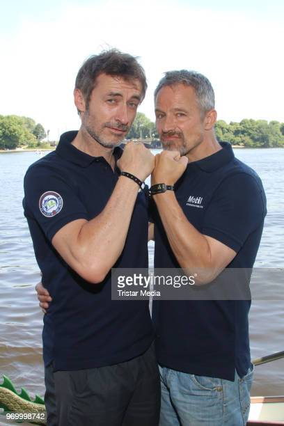 German actor Guido Broscheit and Andreas Brucker attend the '14 Drachenboot Cup' charity event on June 8 2018 in Hamburg Germany