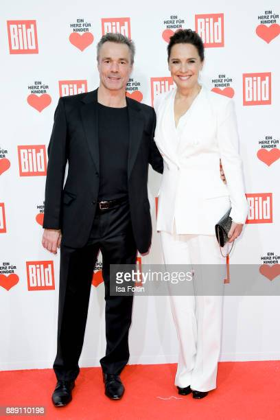 German actor Hannes Jaenicke and presenter Desiree Nosbusch attend the 'Ein Herz fuer Kinder Gala' at Studio Berlin Adlershof on December 9 2017 in...