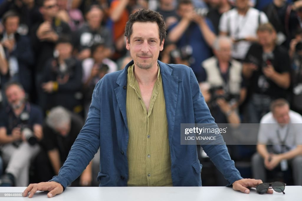 German actor Hans Loew poses on May 17, 2018 during a photocall for the film 'In My Room' at the 71st edition of the Cannes Film Festival in Cannes, southern France.