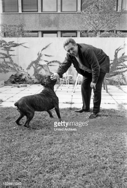 German actor Hans Musaeus at his garden playing with his dog, Germany, 1960s.