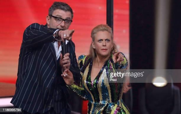 German actor Hans Sigl and German entertainer Barbara Schoeneberger joke around during the Ein Herz Fuer Kinder Gala show at Studio Berlin Adlershof...