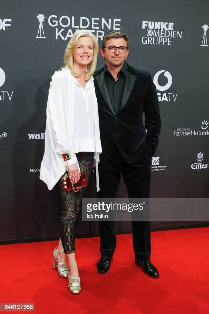 German actor Hans Sigl and his wife Susanne Sigl arrive for the Goldene Kamera on March 4, 2017 in Hamburg, Germany.