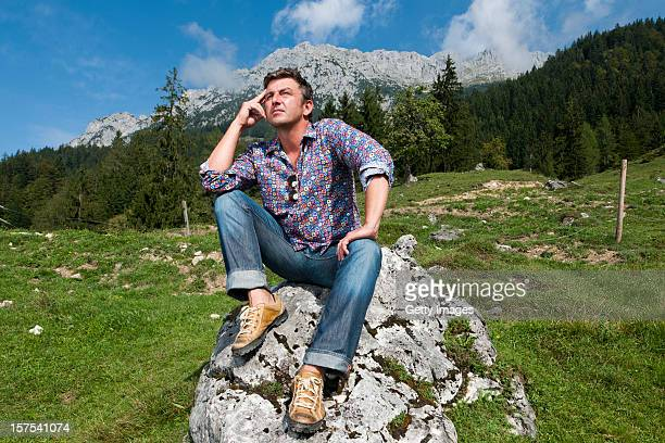 German actor Hans Sigl poses for a picture as he visits the filming location of GermanAustrian tv serie 'Der Bergdoktor' on September 17 2011 in...