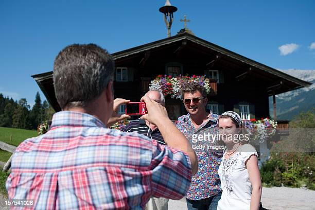 German actor Hans Sigl poses with a fan for a picture as he visits the filming location of GermanAustrian tv serie 'Der Bergdoktor' on September 17...