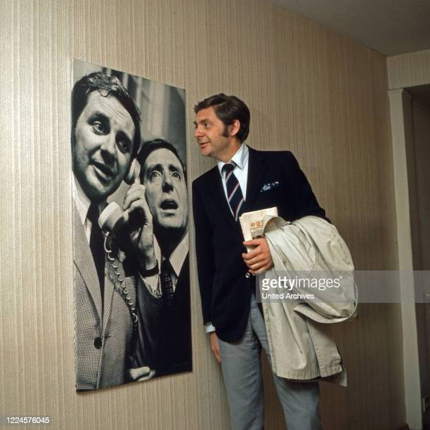 German actor Harald Juhnke watching a poster of himself with colleague Hans Clarin Germany 1960s