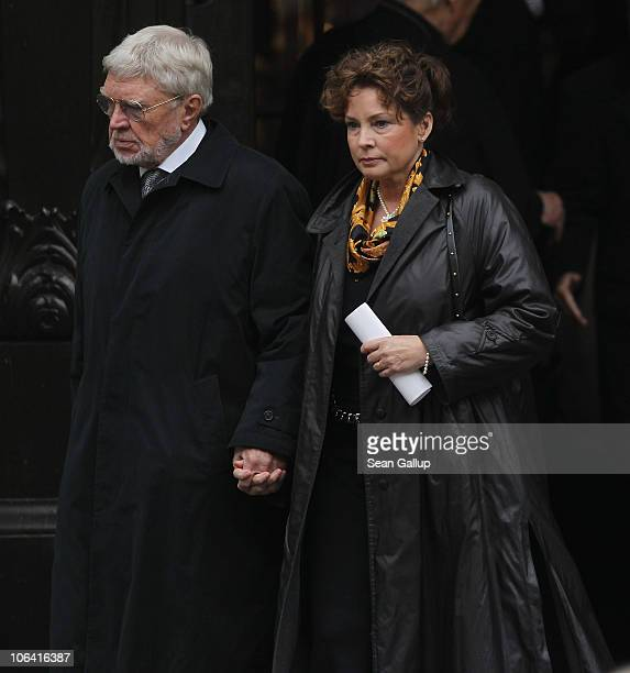 German actor Hardy Krueger and his wife Anita Krueger depart following the memorial service for Loki Schmidt wife of former German Chancellor Helmut...