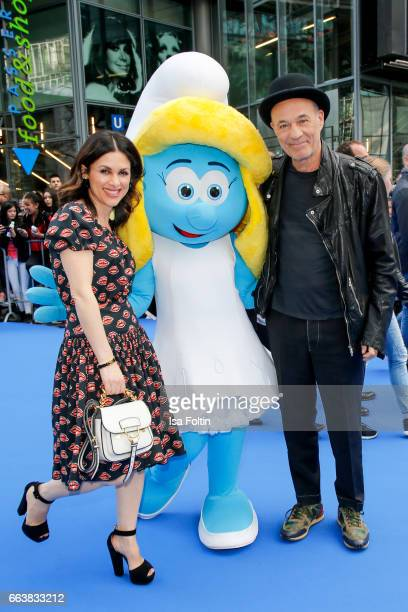 German actor Heiner Lauterbach and his wife Viktoria Lauterbach with smurf 'Schlumpfine' during the 'Die Schluempfe Das verlorene Dorf' premiere at...
