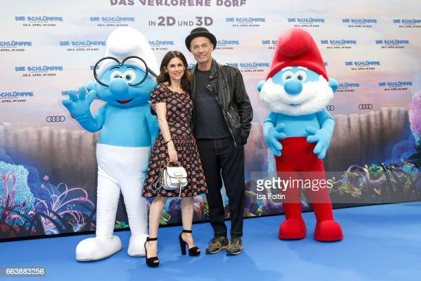 German actor Heiner Lauterbach and his wife Viktoria Lauterbach with the smurfs 'Schlaubi' and 'Papa Schlumpf' during the 'Die Schluempfe Das...