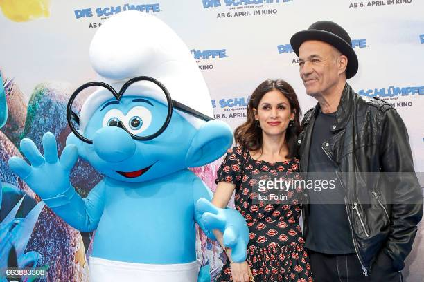 German actor Heiner Lauterbach and his wife Viktoria Lauterbach with smurf 'Schlaubi' during the 'Die Schluempfe Das verlorene Dorf' premiere at Sony...