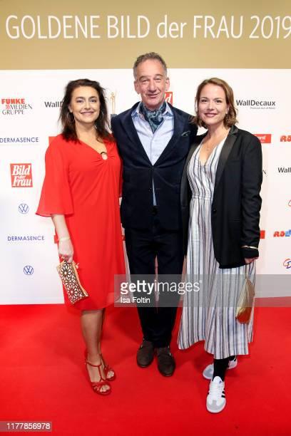 German actor Heio von Stetten with his wife Elisabeth Romano and German actress Marion Mitterhammer attend the annual Goldene Bild der Frau award on...