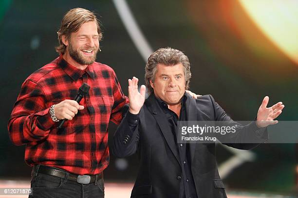 German actor Henning Baum and german singer Andy Borg during the tv show 'Willkommen bei Carmen Nebel' at Velodrom on October 1 2016 in Berlin Germany