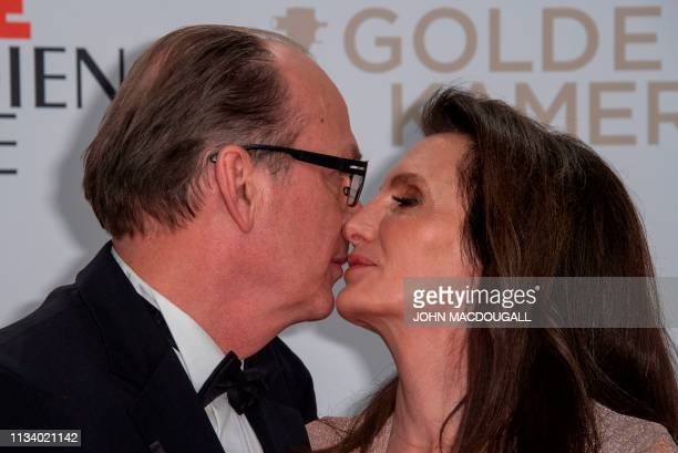 German actor Herbert Knaup and his wife Christiane pose on the red carpet prior to the annual German film and television awards 'Golden Camera' of...