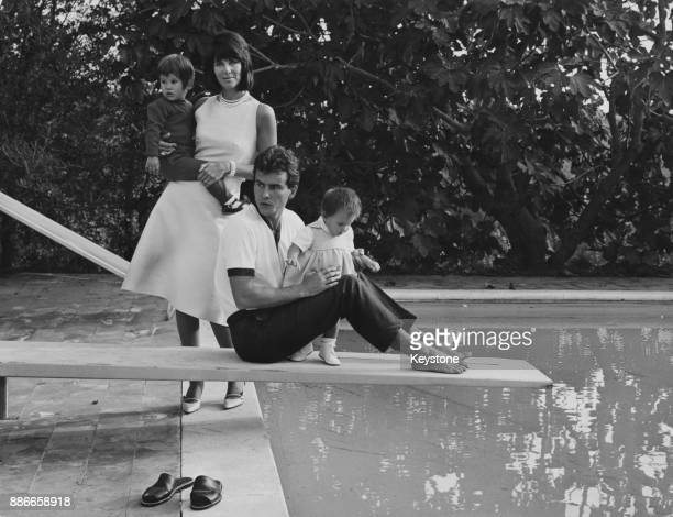 German actor Horst Buchholz and French actress Myriam Bru with their children Christopher and Beatrice at their rented villa on the Via Cassia in...