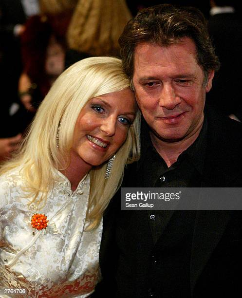 German actor Jan Fedder arrives with his wife Marion at the Tribute to Bambi gala charity held on November 26 2003 in Hamburg Germany
