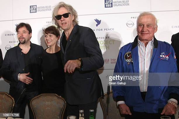German actor Jan Josef Liefers actress Anna LoosLifers Sir Bob Geldof and Astronaut Buzz Aldrin attend the Cinema For Peace Press Conference during...