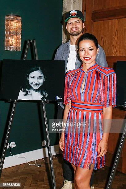 German actor Jimi Blue Ochsenknecht and brazilian singer Fernanda Brandao attend the photo exhibition 'Die Kunst des Kinderlaechelns' by Peter Badge...