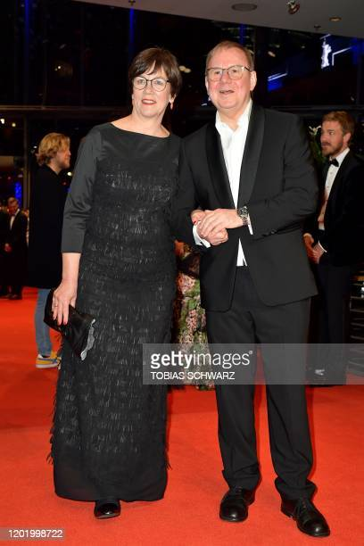 German actor Joachim Krol and his wife Heidrun Teusner pose on the red carpet before the opening ceremony of the 70th Berlinale international film...