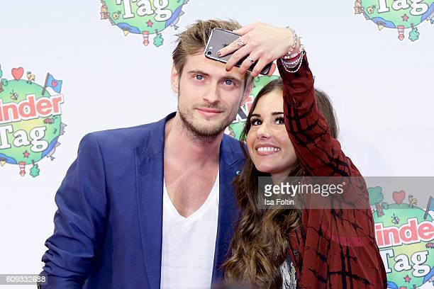 German actor Joern Schloevoigt and singer Sarah Lombardi make a selfie during the KinderTag to celebrate children's day on September 20 2016 in...