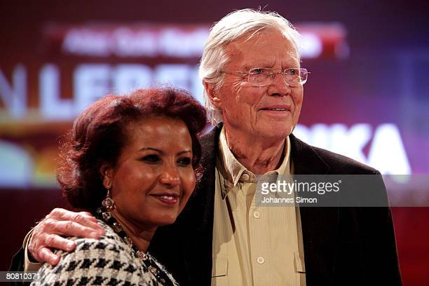 German actor Karlheinz Boehm and his wife Almaz pose during a press conference at Bavaria Film television studios on April 21 2008 in Gruenwald...