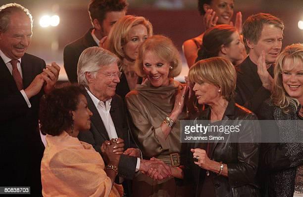 German actor Karlheinz Boehm is congratulated by Friedrich von Thun his wife Almaz Alice and Ellen Kessler Uschi Glas Yvonne Catterfeld Dennenesch...