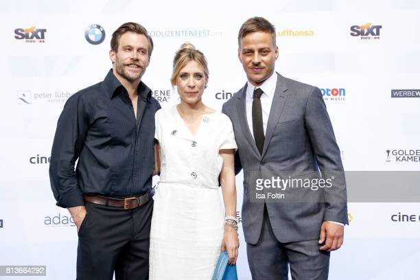 German actor Ken Duken with his wife Marisa Leonie Bach and German actor Tom Wlaschiha attend the summer party 2017 of the German Producers Alliance...