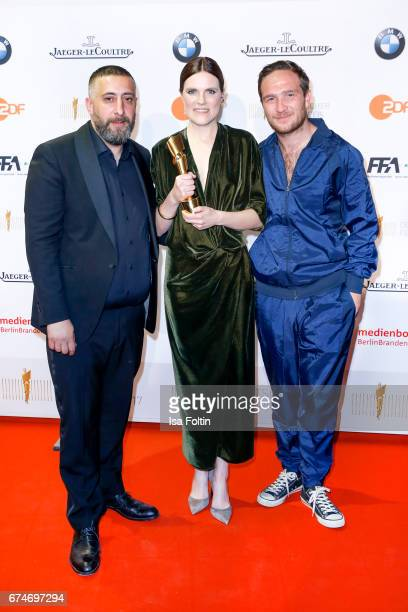 German actor Kida Khodr Ramadan, german actress and award winner for the best female featured part Fritzi Haberlandt and laudator Frederick Lau at...