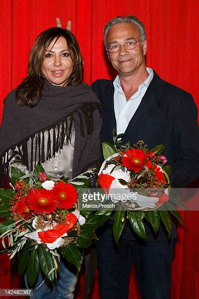 German actor Klaus J Behrendt makes bunny ears behind costar Simone Thomalla whilst posing for pictures after the screening of the Tatort double...
