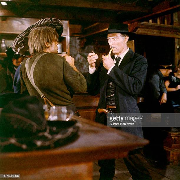 German actor Klaus Kinski and American actor Lee Van Cleef on the set of For a Few Dollars More written and directed by Italian Sergio Leone