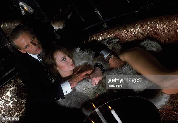 German actor Klaus Kinski and French actress Francoise Fabian on set of the movie Madame Claude directed by Just Jaeckin