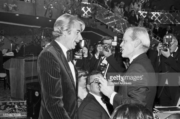 German actor Klaus Kinski and Rudi Carrell at the Deutscher Filmball on January 15th 1979 at Munich Germany 1970s