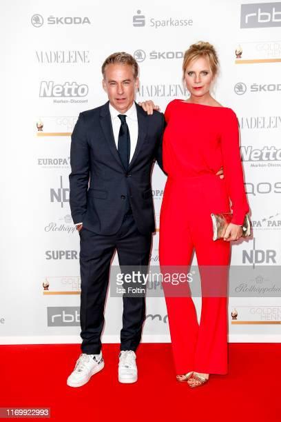 German actor Marco Girnth and his partner German actress Melanie Marschke attend the Goldene Henne at Messe Leipzig on September 20 2019 in Leipzig...