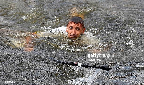 German actor Mark Keller falls ino the water during the Stand Up Paddling celebrity race at Magellan Terassen on August 16 2013 in Hamburg Germany