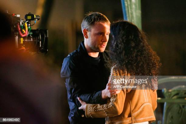 German actor Max Riemelt and Indian actress Tina Desai play a scene on the set of Netflix TV scifi series Sense8 in the Montmartre area of Paris on...
